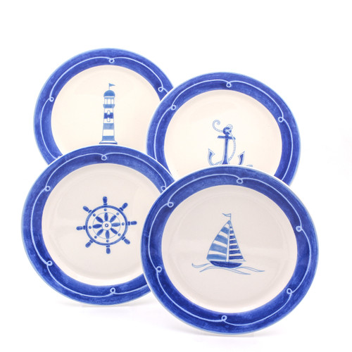 four salad plates with blue rims and assorted blue designs : sail boat, anchor, ship wheel, and lighthouse