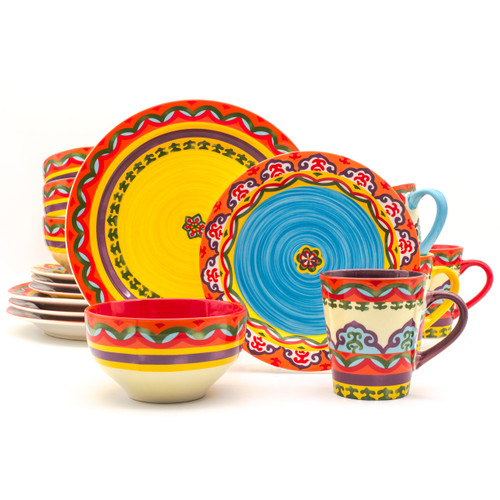 a 16 piece dinnerware set featuring a colorful design and mix-and-match mugs and bowls and salad plates that have various different interior colors of red, yellow, blue, and purple