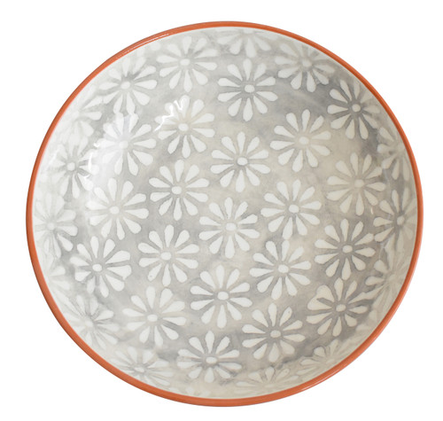 interior of a grey serving bowl with white flowers and a terra cotta exterior