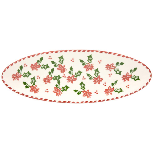 a narrow oval platter with a holly-and-berry pattern