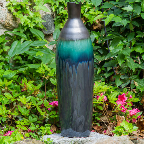 Tall and skinny vase with metallic top and greenish blue drip glaze transitioning to a shiny metallic base