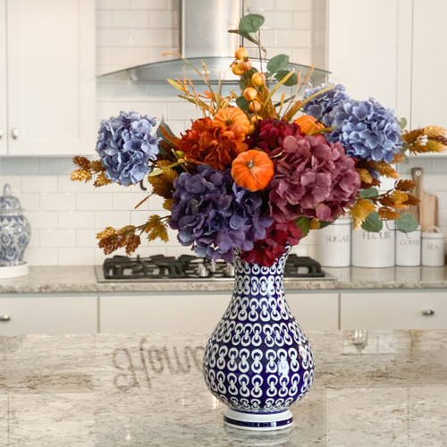 Round and curvy vase with wide lip and blue-and-white hand-painted chain design