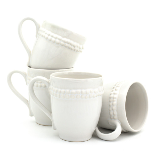 stack of four white mugs with a double ring of beaded detail just under the top of the handle