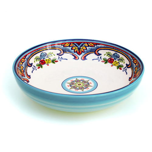 pasta bowl with blue brushed exterior and  a colorful interior design