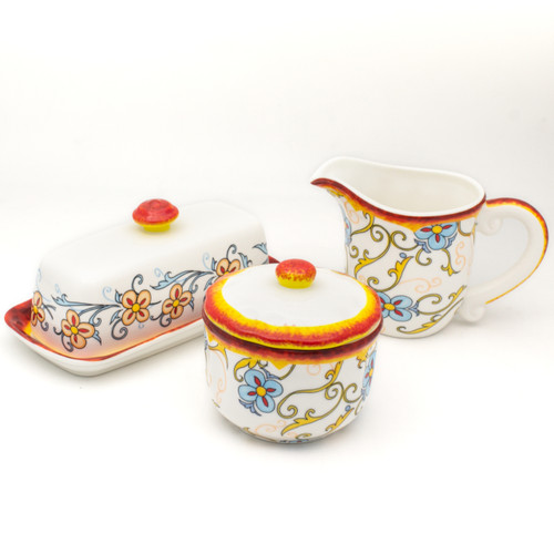 photo of creamer and sugar jar and butter container with floral decal pattern