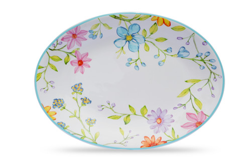 With its understated pastel tones, Charlotte Collection adds both a radiant and cozy artisan touch to each meal. Round out your dining table with matching serve ware to set an elegant presentation. Charlotte's watercolor design will layer and mix and match with dishes that enhance the vast range of fresh delicate flowers decorating each piece. Crafted of high fired stoneware, Charlotte is dishwasher, microwave, freezer, and oven safe (up to 400° F). Imported.