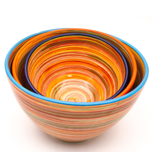 """Experience the joy of painting with the Raia Collection by Euro Ceramica. Completely hand-painted by Spanish artisans, every stripe and swirl of the Raia design is unique to the character of that piece. With no two plates exactly alike, the charm of the colorful rainbow of oranges or blues will shine on any table. Each set in the collection comes in an assortment of four rim colors - cobalt, turquoise, green, and orange – lending even more distinction to the dishes and opening a world of mix-and-match potential. The Stacking Bowl set includes a small (6""""), medium (8""""), and large (9"""") stacking bowl. This cute trio is perfect for every step of meal prep, from mixing ingredients and holding chopped veggies straight to the table for a charming display. Dishwasher and Microwave safe, Raia lends itself to that every night casual meal, but can also easily be dressed up for a full tablescape. To create your perfect table setting, host a mix-your-own salad or taco night with the Raia stacking bowls and meal bowls. Let guests scoop their toppings from the stacking bowls straight into their personal meal bowl! Or accent any table setting, from traditional white to colorful, with a fresh green salad and other sides in the central bowl trio for a distinct pop at every meal."""
