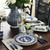 The blue dinnerware is easy to mix and match with light or dark kitchen and home decor and matches great with modern farmhouse or country home decor.