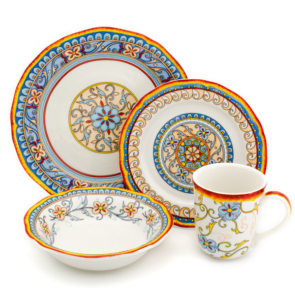 An ornately decorated place setting of dinnerware with scalloped edges and a gold and turquoise floral design.