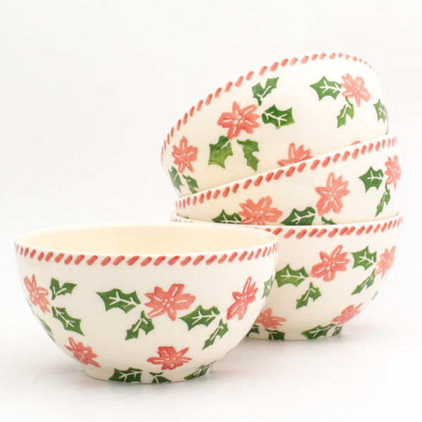 four individual bowls with a holly and berry design