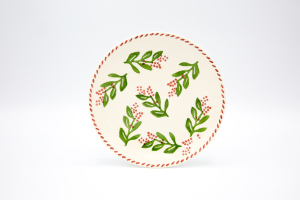 assorted design salad plate featuring variations on a holly and berry design