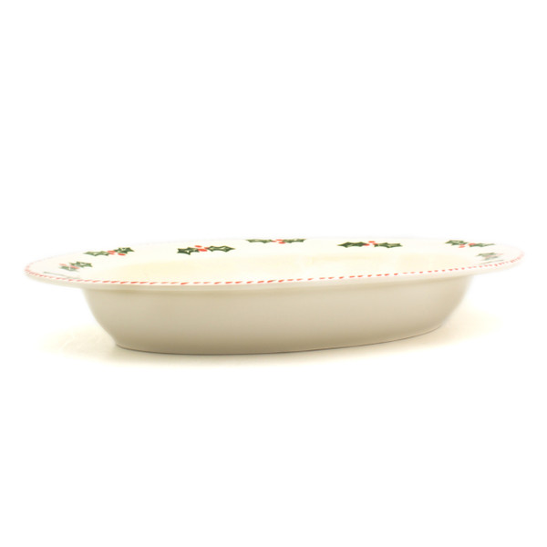 side view of oval platter with rim and holly and berry pattern