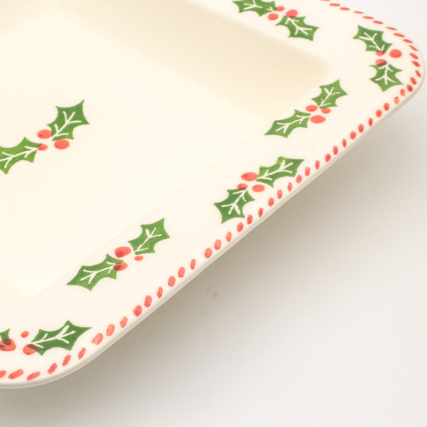 detail view of square platter with holly and berry pattern