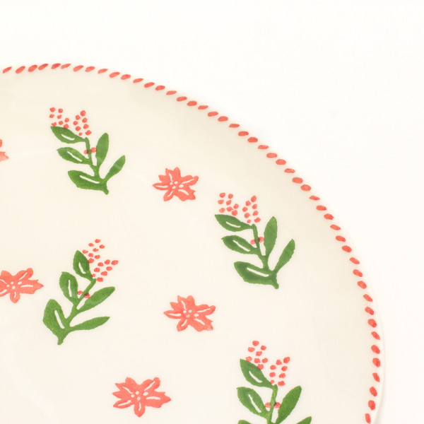 detail view of oval platter with holly and berry pattern