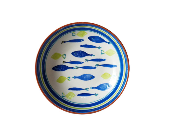interior of a salad bowl featuring a hand-painted fish design