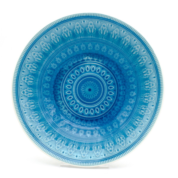 interior of serving bowl in turquoise with crackle glaze and a traditional mandala design.