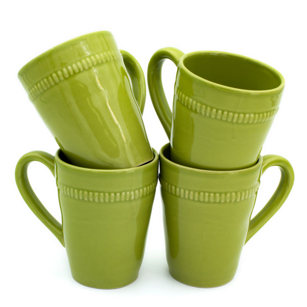 Four green mugs with beaded decoration around the rims displayed in two stacks