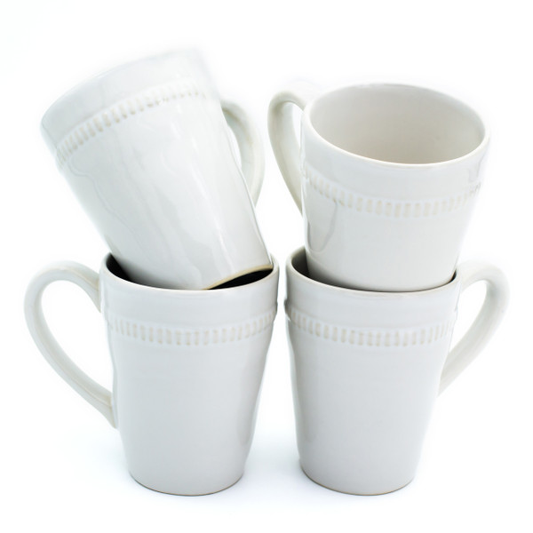 Four white mugs with beaded decoration around the rims displayed in two stacks