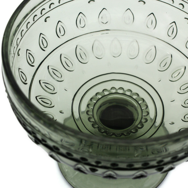 close up of a single grey compote glass with embossed teardrop and mandalas