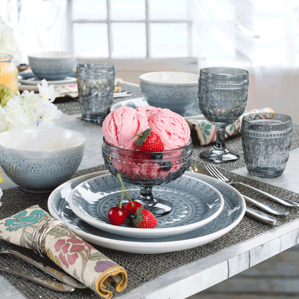lifestyle of a grey compote glass filled with ice cream and sitting on a fez salad plate