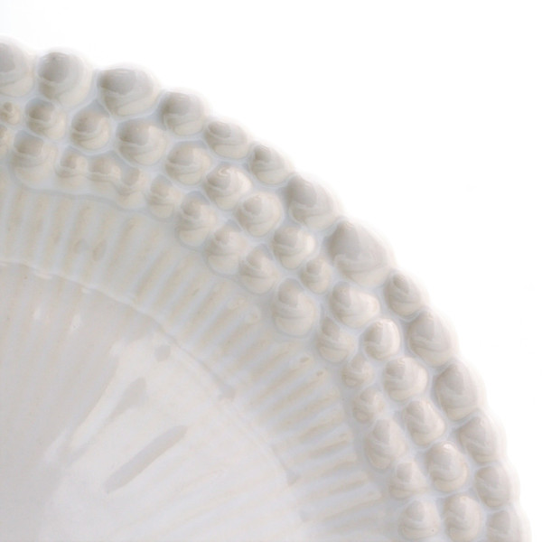 detail showing three rings of beaded engraving around the edge of  a salad plate