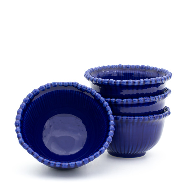 stack of three blue bowls with beaded rims with a forth bowl upended to show the inside