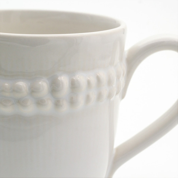 detail showing double ring of bead detail on a mug