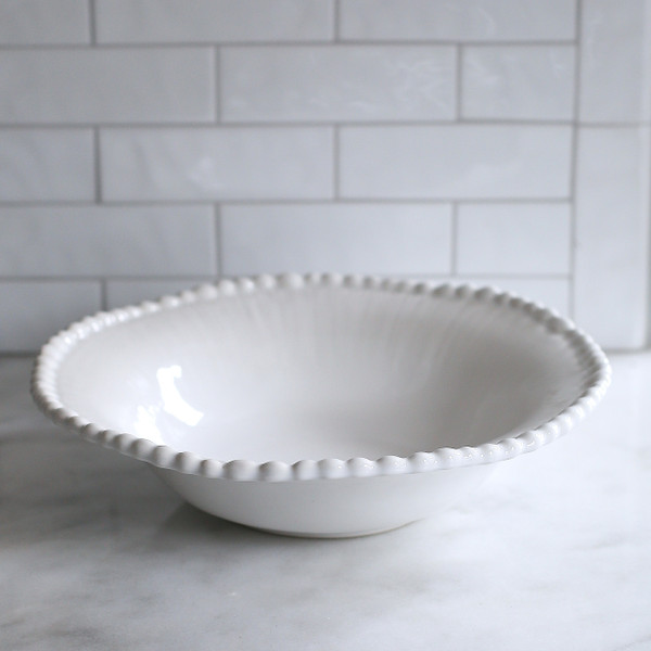 white wide liped large bowl with beads around the rim