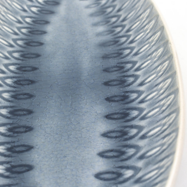 detail view of narrow lagoon platter with crackle glaze and an embossed peacock feather design