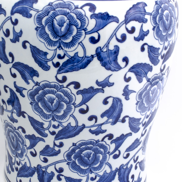 detail view of white garden stool featuring a hand-painted begonia design showing the brush work of the blue begonias