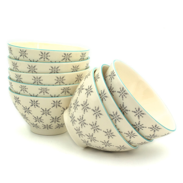 8 white bowls with grey patterns in two stacks one stack slightly in front of the other