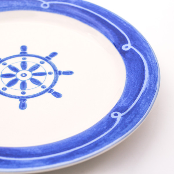Boat steering wheel on blue banded ceramic plate