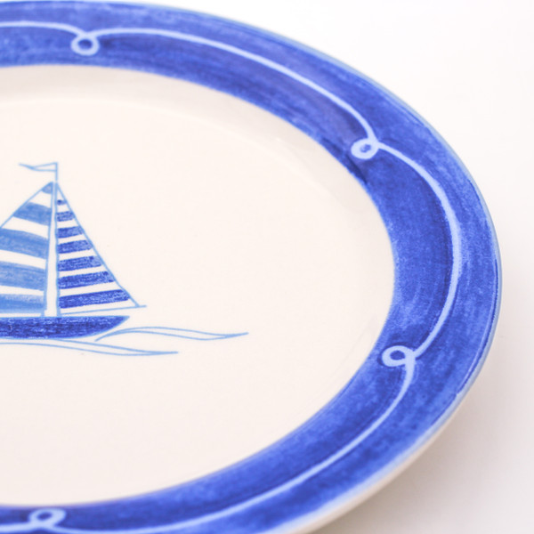Sail boat on blue banded ceramic plate