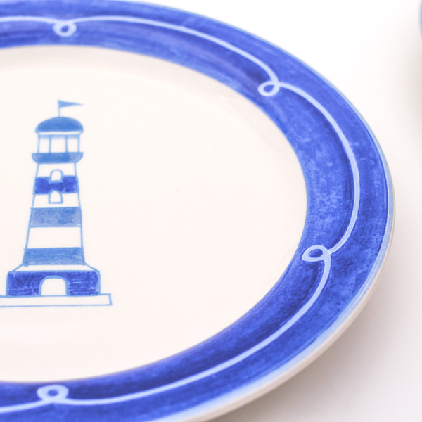 Light house on blue banded ceramic plate