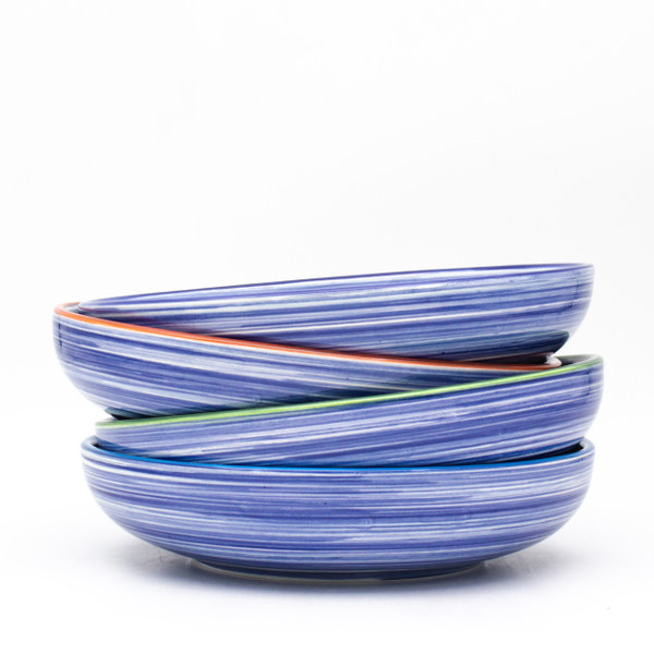 The Meal Bowl set includes four bowls with a wide mouth and generous 34oz capacity, perfect for pasta, rice bowls, and weeknight dinners. Dishwasher and Microwave safe, Raia lends itself to that every night casual meal, but can also easily be dressed up for a full tablescape. To create your perfect table setting, lay the Raia Meal Bowl on a solid colored dinner plate, coordinated to match the rim of the bowl, then top with a solid cereal bowl in the same color. Try our Algarve collection for a combination of tones and stripes that is sure to impress!