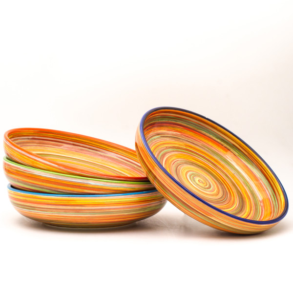 Experience the joy of painting with the Raia Collection by Euro Ceramica. Completely hand-painted by Spanish artisans, every stripe and swirl of the Raia design is unique to the character of that piece. With no two plates exactly alike, the charm of the colorful rainbow of oranges or blues will shine on any table.
