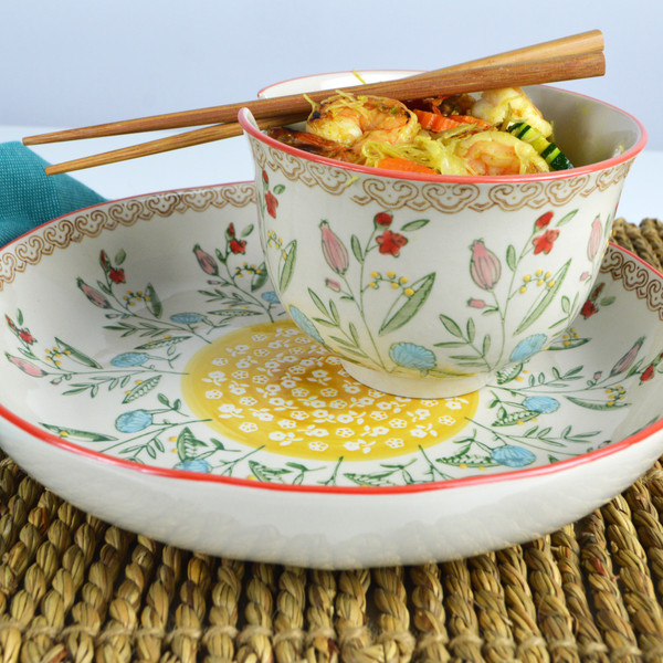 The Ella Ramen and Dinner Bowl Set is both beautiful and perfectly practical. The lovely floral designs of the Ella collection are reminiscent of the traditional block printed Sanganer patterns of Indian textiles. Each bowl shape has a unique design and is hand painted and finished by trained artisans.