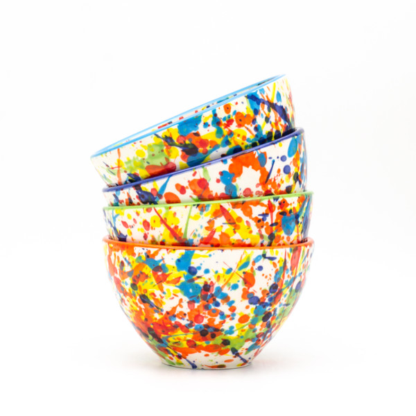 Experience the joy of painting with the Pintura Collection by Euro Ceramica.  Completely hand-painted by Spanish artisans, every splash and pulse of the Pintura design is unique to the character of that piece. With no two plates exactly alike, the exciting explosion of color will lend endless variation and excitement to any table or meal. Each set in the collection comes in an assortment of four rim colors - cobalt, turquoise, green, and orange – lending even more distinction to the dishes and opening a world of mix-and-match potential.  The Cereal Bowl set includes four bowls with a generous 24oz capacity and steep walls, perfect for everything from cereal to ice cream to a heaping bowl of warm soup. Dishwasher and Microwave safe, Pintura lends itself to that every night casual meal, but can also easily be dressed up for a full tablescape.  To create your perfect table setting, skip the salad and lay the Pintura bowl directly on an oversized white dinner (like our Algarve plates!) for a striking combination. Guests can use the bowl for salad or save it for the desert!