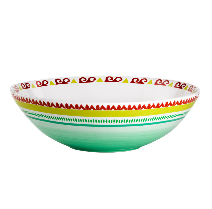 a short wide serving bowl featuring a multicolor design of greens, yellows and reds