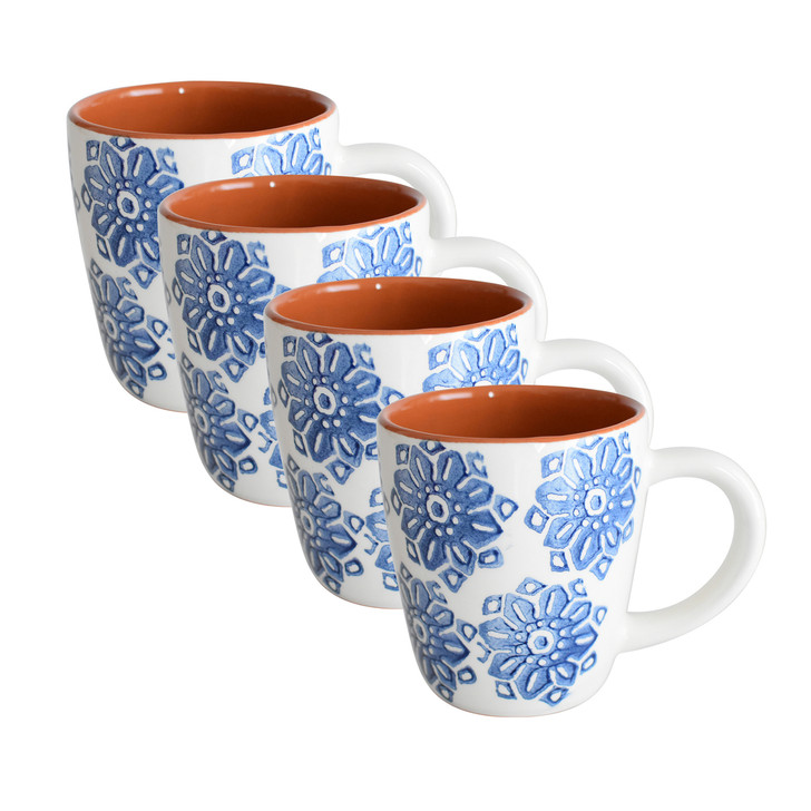 four mugs with blue flowers on the outside and terra cotta on the inside and white handles