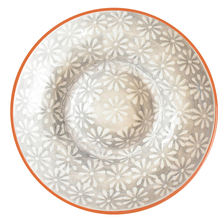 interior of a large chip and dip platter with grey and white flowers and a terra cotta exterior