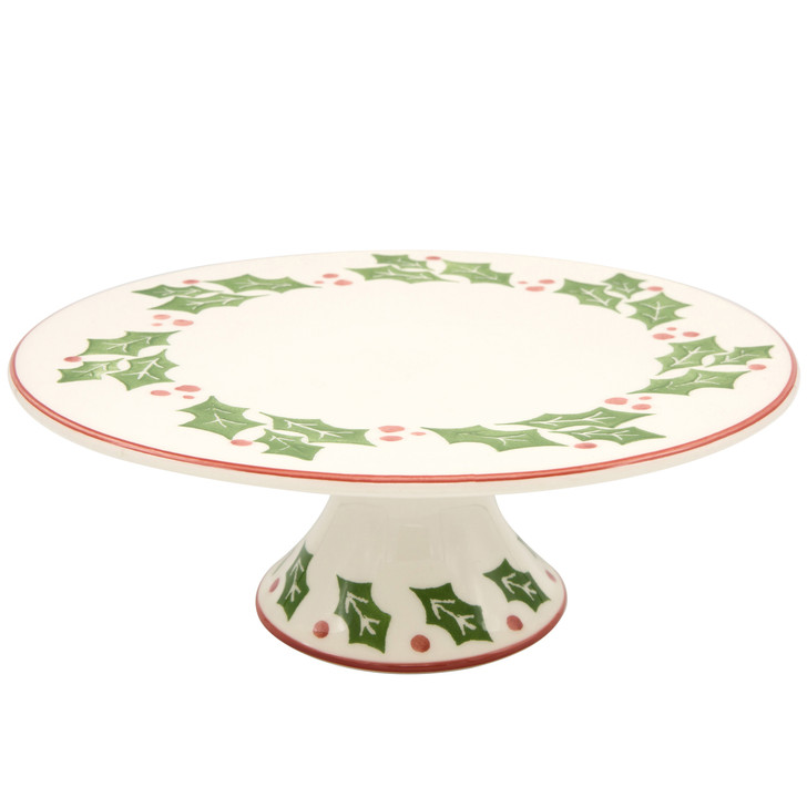 a cake plate with a holly and berry design