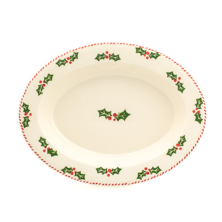 oval platter with rim and holly and berry pattern
