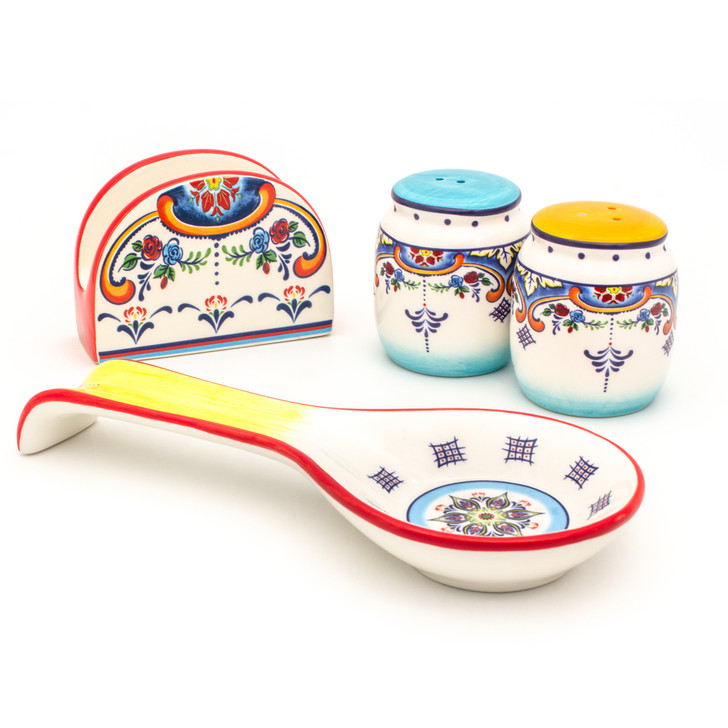 napkin holder, spoon rest and two shakers featuring a colorful feather floral design and blue and yellow brushwork