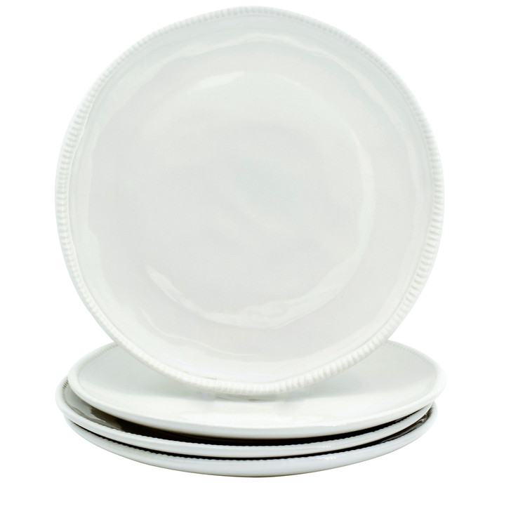 Four white dinner plates with beaded detail around the rim. three are stacked and the fourth sits upright on top of the stack