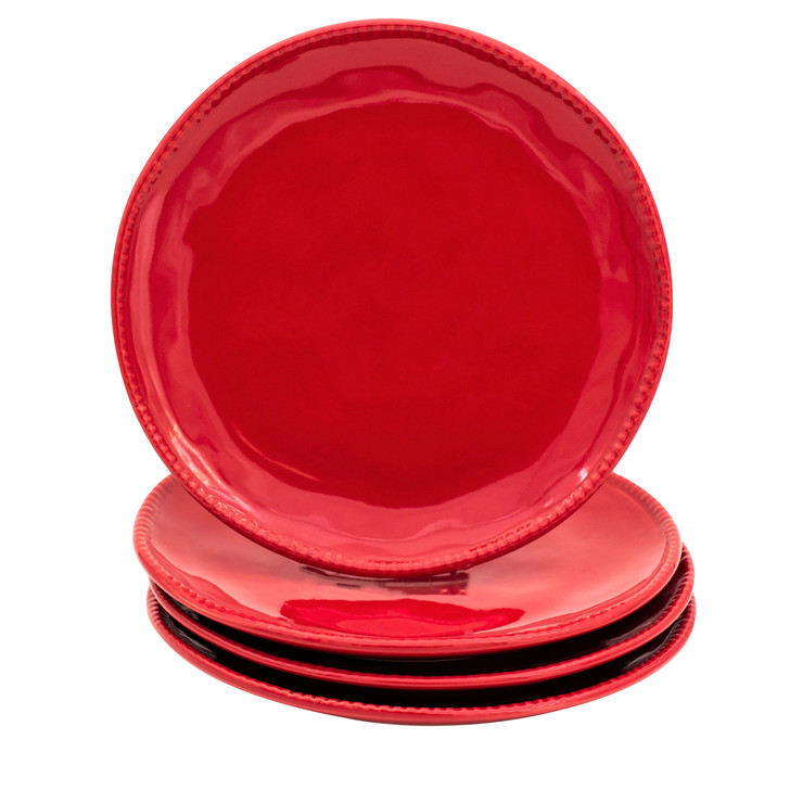 Four red salad plates with beaded detail around the rim. three are stacked and the fourth sits upright on top of the stack