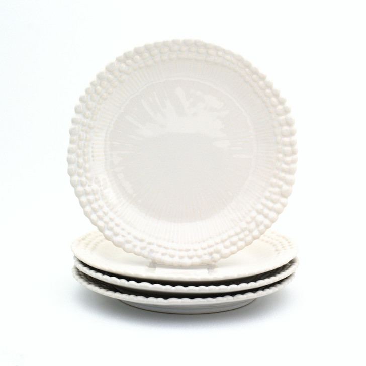 stack of three salad dinner plates with three rings of beads around the rim, a fourth plate standing on the stack