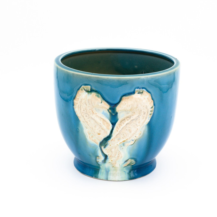 Turquoise planter with two seahorses painted in a white drip glaze