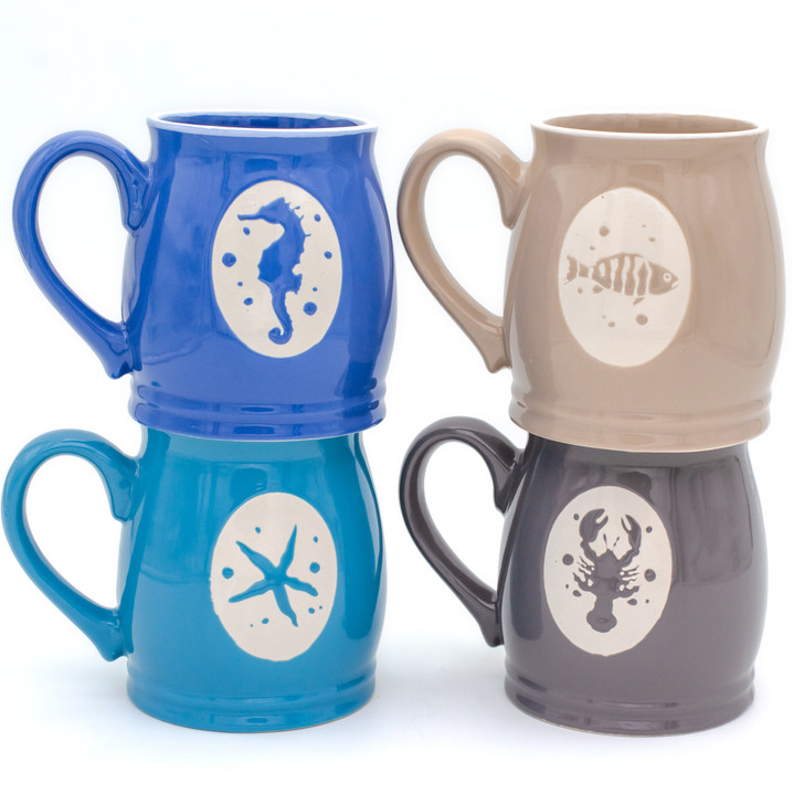 four mugs in two stacks with seahorse, fish, starfish and lobster designs