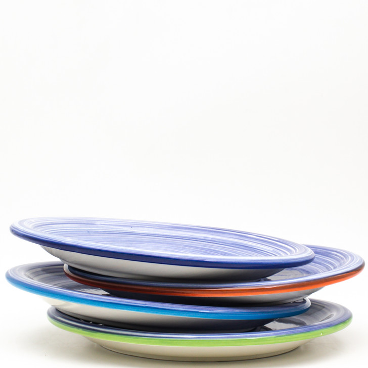 """Experience the joy of painting with the Raia Collection by Euro Ceramica.  Completely hand-painted by Spanish artisans, every stripe and swirl of the Raia design is unique to the character of that piece. With no two plates exactly alike, the charm of the colorful rainbow of oranges or blues will shine on any table. Each set in the collection comes in an assortment of four rim colors - cobalt, turquoise, green, and orange – lending even more distinction to the dishes and opening a world of mix-and-match potential.  The Salad Plate set includes four plates measuring 8.6"""", making perfect accent plates to any solid colored or white table setting. These plates are the perfect size for starter courses, side dishes, or for a stunning desert display. Dishwasher and Microwave safe, Raia lends itself to that every night casual meal, but can also easily be dressed up for a full tablescape.  To create your perfect table setting, set the plate atop a solid color dinner plate that corresponds to the rim color of each piece (our Algarve collection is perfect for this!), or try for a whimsically elegant table by pairing Raia atop a scalloped white dinner. The mixed material of Raia and antique china would make an unforgettable impression on any dinner guest!"""